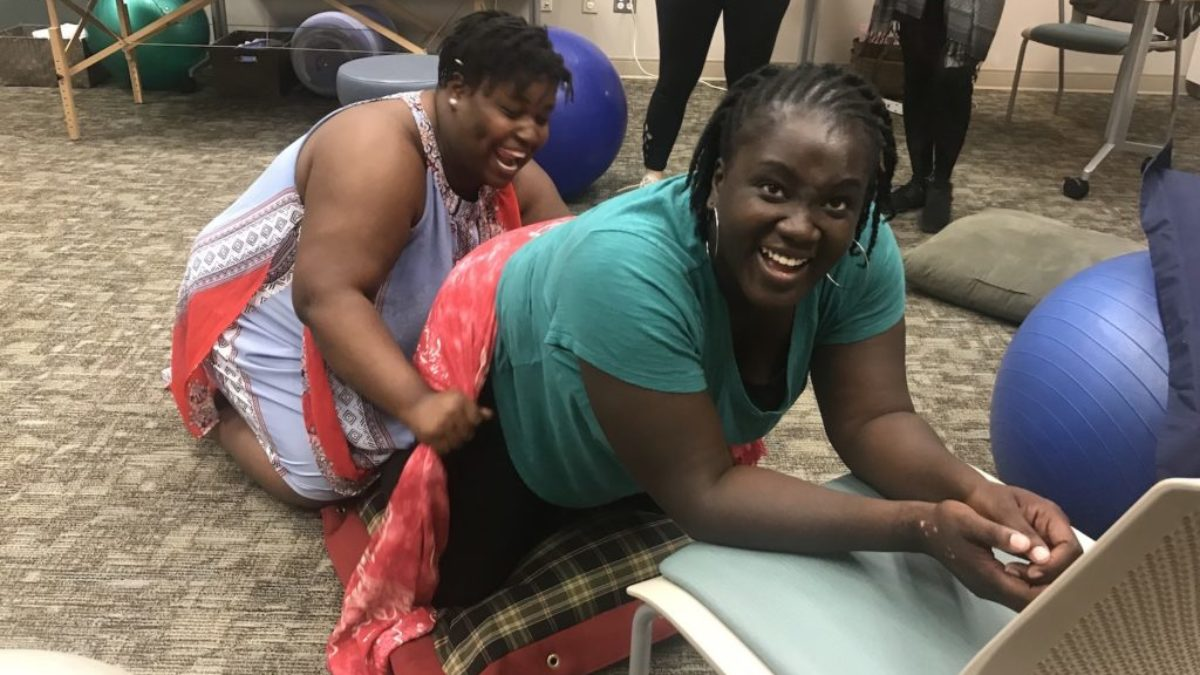 Two women in doula training session
