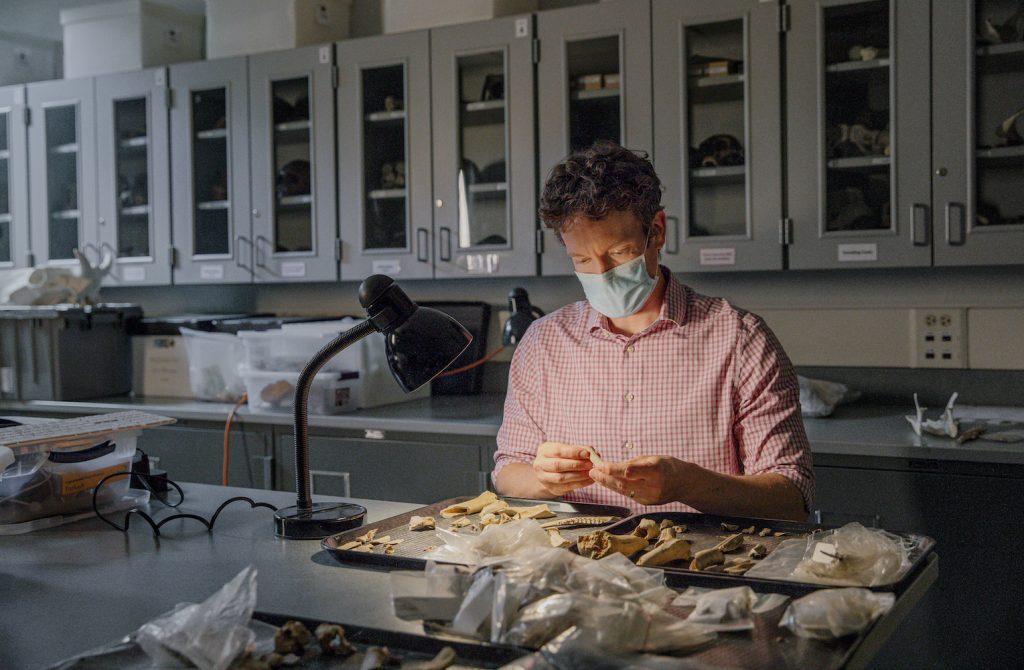 Ben Arbuckle examines animal remains.