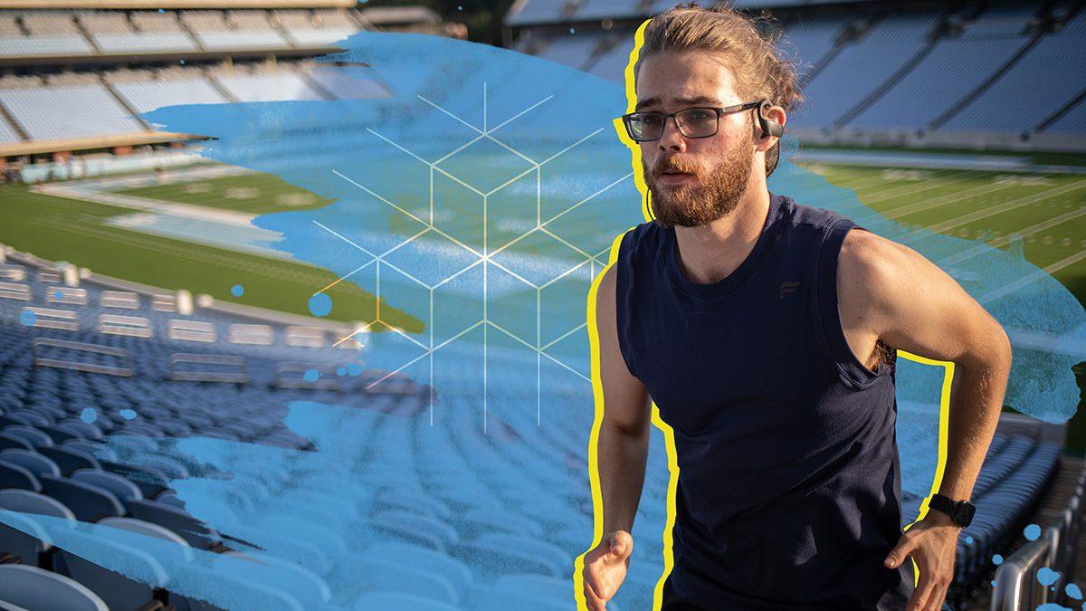 Carolina Covenant Scholar Matthew Wood runs the steps at the football stadium at UNC-Chapel Hill.